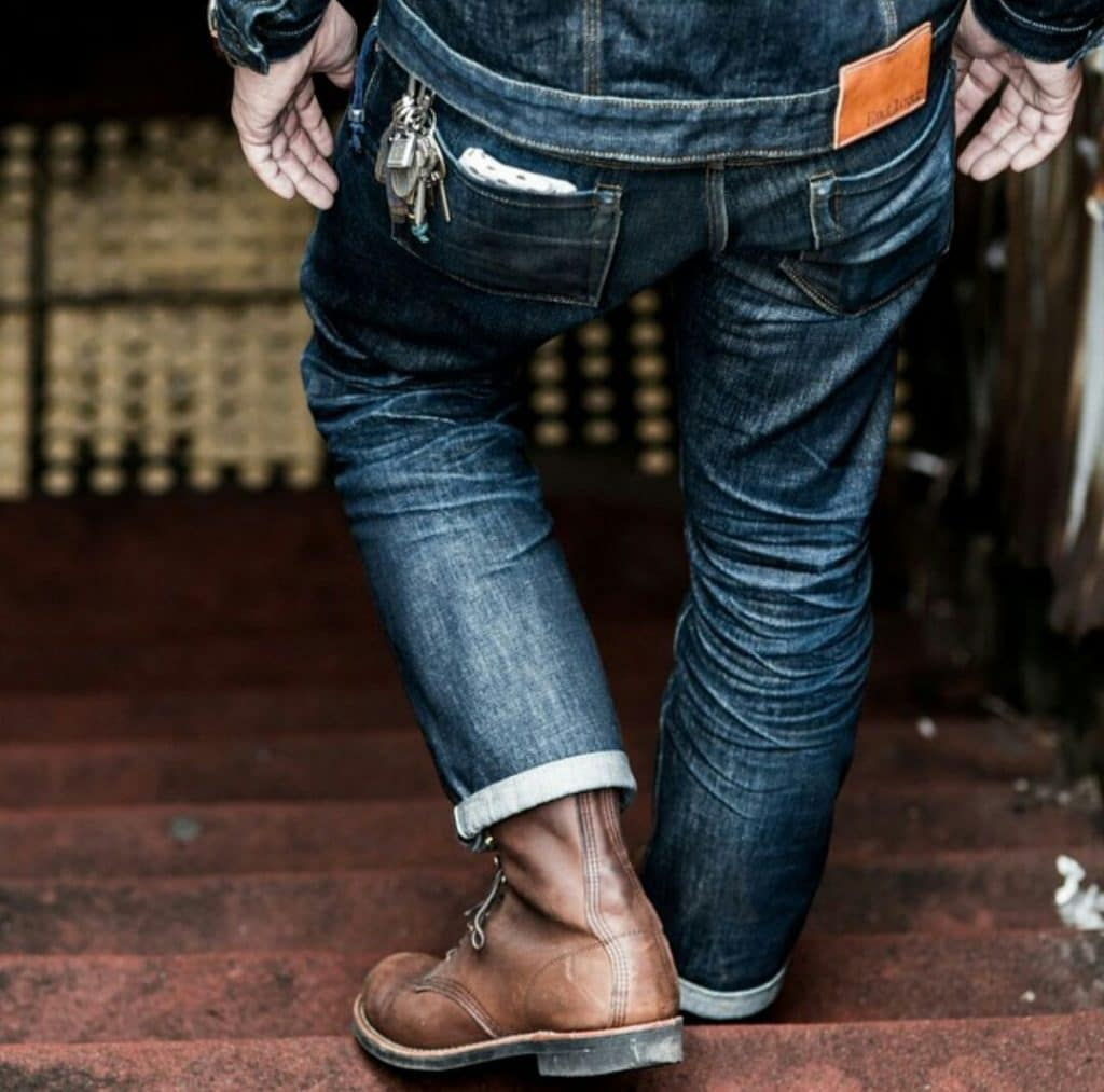 working man walking with jeans and boots on